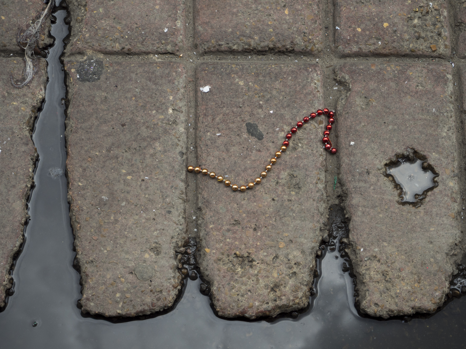 street abstract with found carnival beads