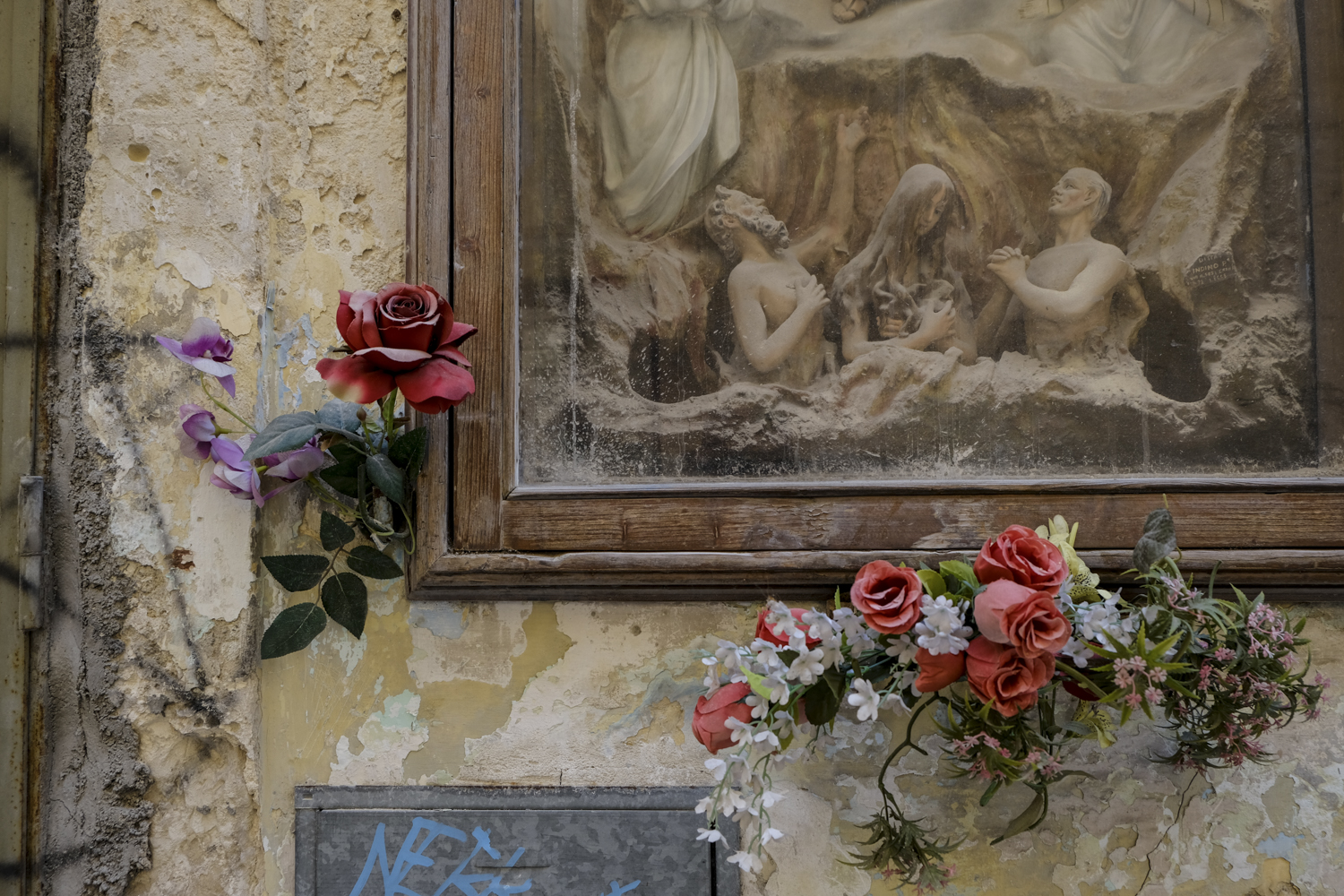 Lecce street shrine and graffiti